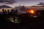 Tourists viewing the lava flow into the ocean at Kamokuna, Big Island, Hawaii