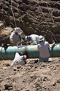Welders on the site of Bayou Bridge Pipeline in Crowley Louisiana.