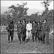 Members of an all-female mine clearence squad, with a male instructor (R), Laos.