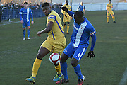 Glossop North End  Anthony Griffith (4) and Scarborough Athletic, Benny Igiehon (9) during the Evo-Stik Premier League match between Glossop North End and Scarborough Athletic at the Arthur Goldthorpe Stadium, Glossop, United Kingdom on 26 November 2016. Photo by Mark Pollitt.