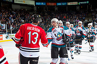 KELOWNA, CANADA - APRIL 14: Gordie Ballhorn #4 of the Kelowna Rockets shakes hands with Keegan Iverson #13 of the Portland Winterhawks after the series win on April 14, 2017 at Prospera Place in Kelowna, British Columbia, Canada.  (Photo by Marissa Baecker/Shoot the Breeze)  *** Local Caption ***