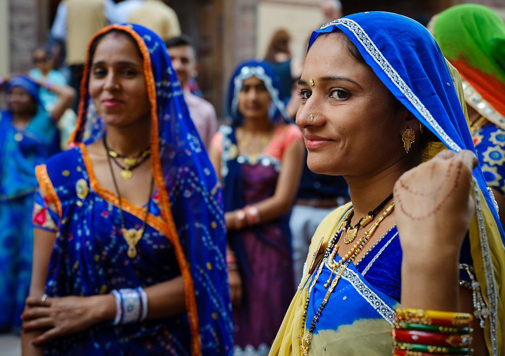 JODHPUR, INDIA - CIRCA NOVEMBER 2018: Portrait of Indian woman wearing traditional saree at the Mehrangarh Fort in Jodhpur. The fort is one of the largest forts in India. Built in around 1459 by Rao Jodha, the fort is situated above the city and is enclosed by imposing thick walls. Jodhpur is the second largest city in the Indian state of Rajasthan. Jodhpur is a popular tourist destination, featuring many palaces, forts and temples, set in the stark landscape of the Thar Desert. It is popularly known as Blue city and Sun city among people of Rajasthan and all over India