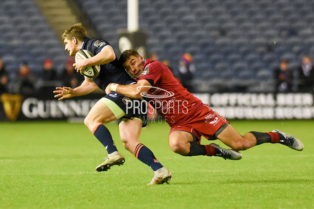 James Johnstone is tackled by his opposite number Kieron Fonotia during the Guinness Pro 14 2018_19 match between Edinburgh Rugby and Scarlets at BT Murrayfield Stadium, Edinburgh, Scotland on 2 November 2018.