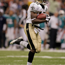 2009 September 03: New Orleans Saints wide receiver Rod Harper (13) returns a punt for a touchdown in the fourth quarter of a preseason game between the Miami Dolphins and the New Orleans Saints at the Louisiana Superdome in New Orleans, Louisiana.