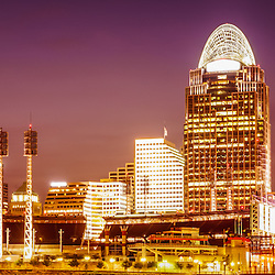 Cincinnati skyline at night panoramic picture with downtown city office buildings including Great American Ballpark, Great American Insurance Group Tower, PNC Tower building, Omnicare building, US Bank building, Carew Tower building, Scripps Center building, and Fifth Third building. Panoramic photo ratio is 1:3.