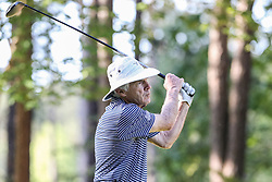 Bobby Johnson tees off on the 10th hole during the Chick-fil-A Peach Bowl Challenge at the Ritz Carlton Reynolds, Lake Oconee, on Tuesday, April 30, 2019, in Greensboro, GA. (Karl L. Moore via Abell Images for Chick-fil-A Peach Bowl Challenge)