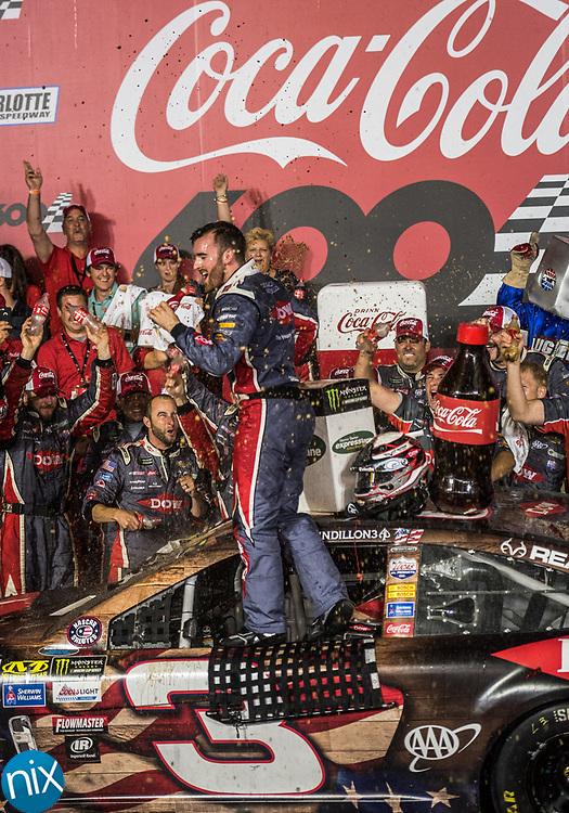 Austin Dillon celebrates winning the Coca-Cola 600 at Charlotte Motor Speedway Sunday, May 28, 2017.