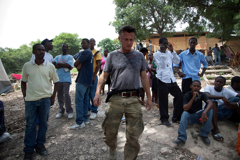 Actor and Founder of J/P HRO Refugee Camp, Sean Penn, meets with refugees after a massive earthquake hit Haiti on July 16, 2010.The camp is estimated to have over 55,000 refugees. Six month after a catastrophic earthquake measuring 7.3 on the Richter scale hit Haiti on January 13, 2010, killing an estimated 230,000 people, injuring an estimated 300,000 and making homeless an estimated 1,000,000.