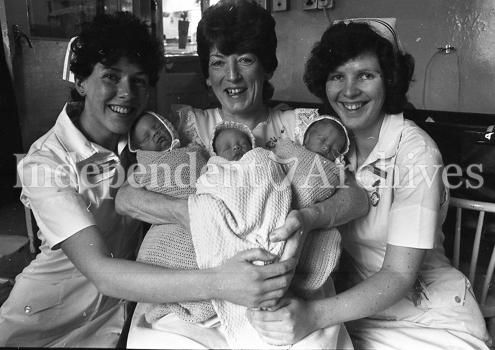 Paula Heavey with her new born triplets Colm, Aime and Martin with nurses Sheila O'Grady and Mary Whitfield from the Rotunda Hospital. (Part of the Independent Newspapers Ireland/NLI Collection)