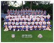 KO OLINA - FEBRUARY 11:  NFL Pro Bowl players pose with the Atlanta Falcons coaching staff and hula girls for the NFC Conference photo on February 11, 2005 in Ko Olina, Hawaii. ©Paul Anthony Spinelli