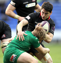 Edinburgh's Sam Hidalgo-Clyne is tackled by London Irish's Scott Steele - Photo mandatory by-line: Robbie Stephenson/JMP - Mobile: 07966 386802 - 05/04/2015 - SPORT - Rugby - Reading - Madejski Stadium - London Irish v Edinburgh Rugby - European Rugby Challenge Cup