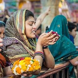 Woman crying during celebration of Holi, Mathura, India