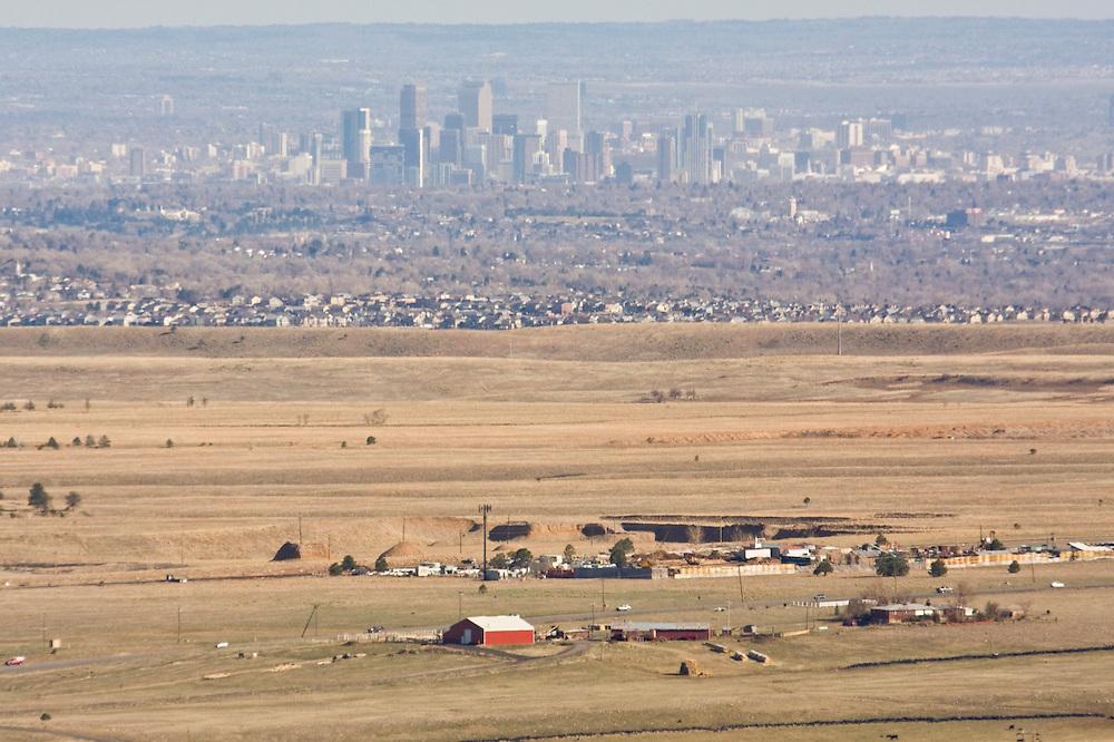 View of Denver downtown skyscrapers, suburbs, and farms from Eldorado Canyon State Park, Colorado.