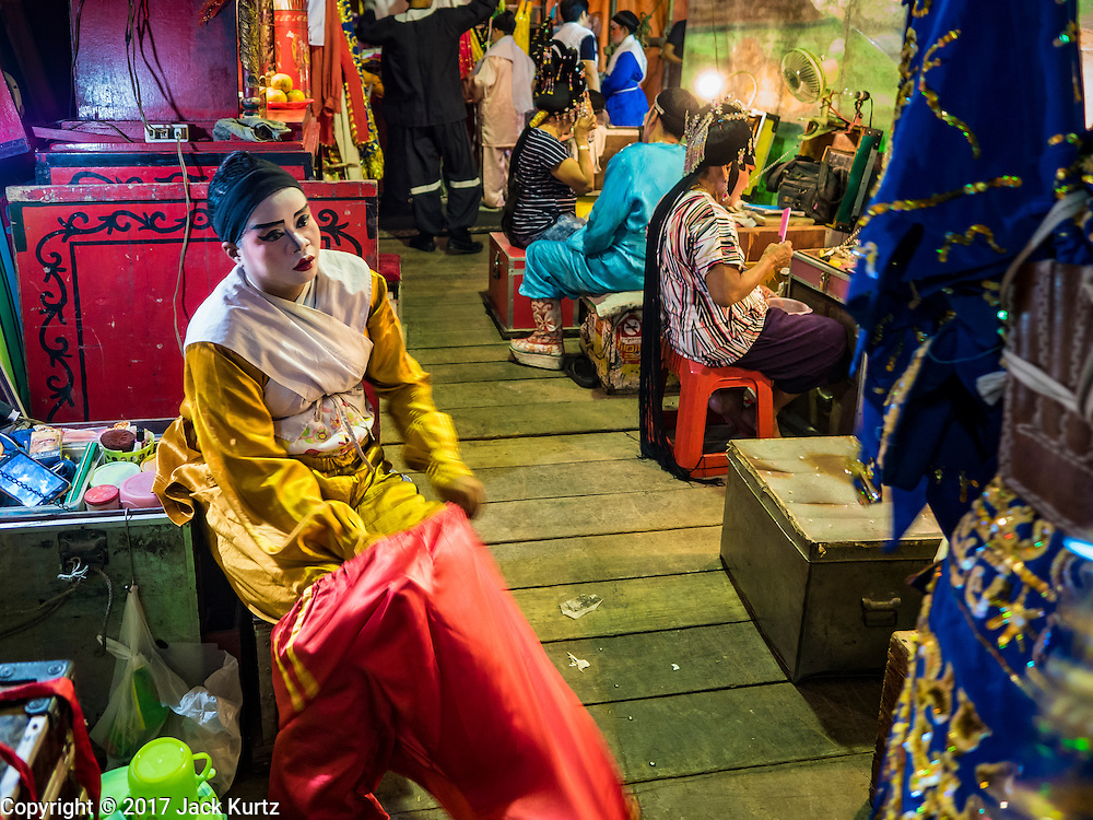 04 FEBRUARY 2017 - BANGKOK, THAILAND: A performer puts on her costume before going on stage for the Lunar New Year at the Phek Leng Keng Shrine in the Khlong Toey section of Bangkok. Many Chinese shrines and temples host Chinese operas during the Lunar New Year. Lunar New Year was January 28 this year and opera troupes are finishing their holiday engagements at the local temples.     PHOTO BY JACK KURTZ