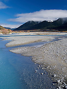 The turquoise waters of the Waimakariri River, with the Polar Range in the background.  New Zealand.