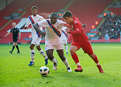 LIVERPOOL, ENGLAND - Saturday, January 8, 2011: Liverpool's 'Suso' Jesus Fernandez Saez and Crystal Palace's Aaron Akuruka during the FA Youth Cup 4th Round match at Anfield. (Pic by: David Rawcliffe/Propaganda)