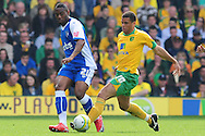 London - Saturday, April 17th 2010: Darel Russell of Norwich City and Dennis Oli of Gillingham during the Coca Cola League One match at Carrow Road, Norwich..(Pic by Alex Broadway/Focus Images)