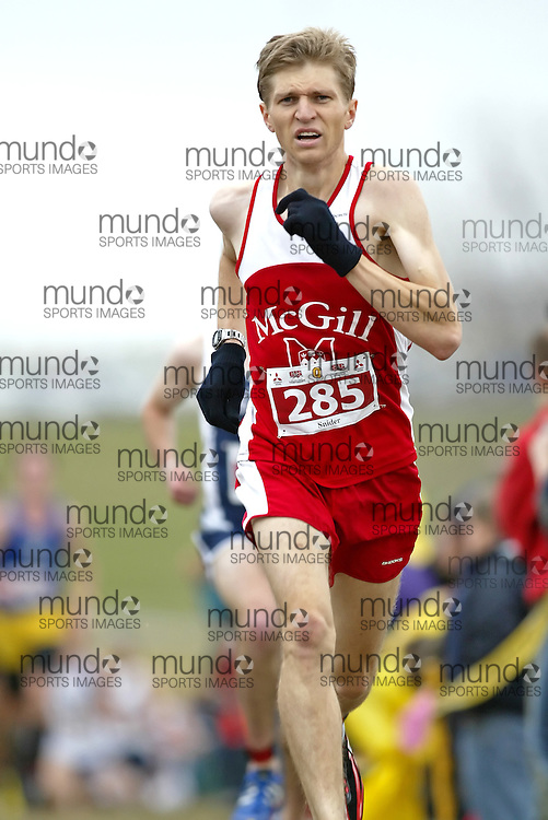 (Kingston, Ontario -- 14 Nov 2009)  GRAYDON SNIDER of the McGill University runs to 36 place at the  2009 Canadian Interuniversity Sport CIS Cross Country Championships at Forth Henry Hill in Kingston Ontario. Photograph copyright Sean Burges / Mundo Sport Images, 2009.