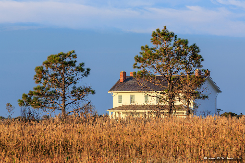 A photo of the Bodie island Lightkeepers house at sunrise.
