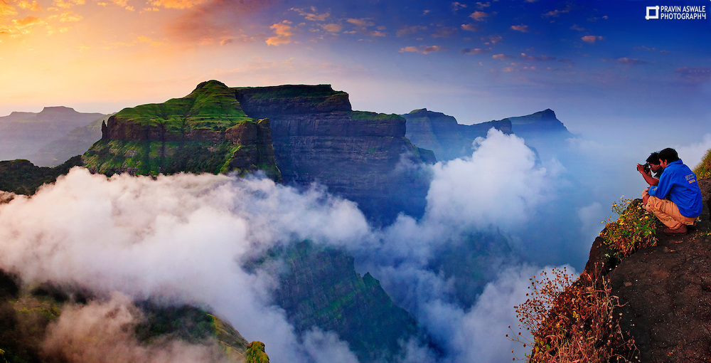 This was shot back in 2007, my very first adventure Trek to Fort Ratangad, Sahyadri, Western Ghats India. very mesmarising colours, the clouds under were below us, the enormous CLIFF of Mount Katrabai, everything was Tranquilising!