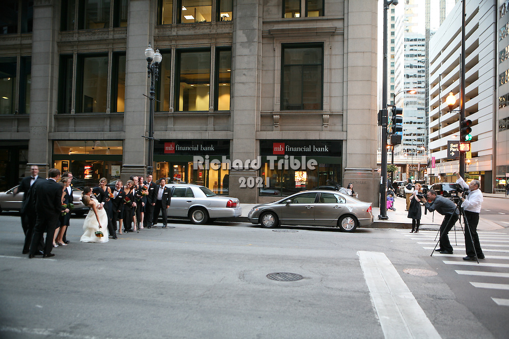 Photographing a wedding party in the middle of downtown chicago. Apparently this is becomming a trend as I saw it once in Denver.
