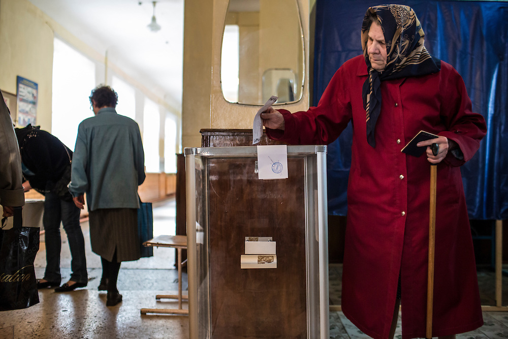DONETSK, UKRAINE - MAY 11: A woman casts her ballot on May 11, 2014 in Donetsk, Ukraine. A referendum on greater autonomy is being held after pro-Russian activists took over at least ten cities in the eastern part of the country in a bid for less control from the central government from Kiev. (Photo by Brendan Hoffman/Getty Images) *** Local Caption ***
