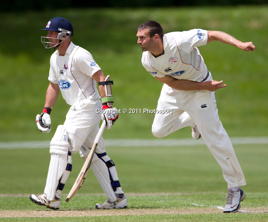Canterbury bowler Andrew Ellis and Gareth Hopkins on day 2 of the 4 Day Plunket Shield cricket match between the Canterbury Wizards and Auckland Aces. Played on MainPower Oval in Rangiora, Canterbury. Tuesday 15 November 2011. Joseph Johnson/photosport.co.nz