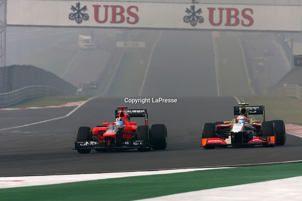&copy; Photo4 / LaPresse<br /> 28/10/2012 Noida, India<br /> Sport <br /> Indian Grand Prix, Noida 25-28 October 2012<br /> In the pic: Timo Glock (GER) Marussia F1 Team MR01 and Narain Karthikeyan (IND) HRT F1 Team F112