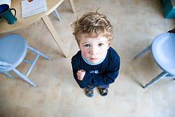 Little boy looking up,