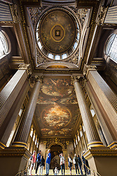 © Licensed to London News Pictures. 25/09/2016. LONDON, UK.  Visitors look at the main hall ceiling and dome at the Painted Hall. The 300 year old Painted Hall by James Thornhill at the Old Royal Naval College closes today for two years. Major restoration work to remove layers of dirt to the fine dining room will be undertaken in the main hall, ceiling and dome. The project has been awarded a £3.1m Heritage Lottery grant.  Photo credit: Vickie Flores/LNP