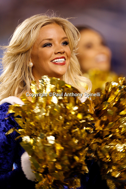 A San Diego Chargers cheerleader smiles and waves pom poms during the NFL week 15 football game against the San Francisco 49ers on Thursday, December 16, 2010 in San Diego, California. The Chargers won the game 34-7. (©Paul Anthony Spinelli)