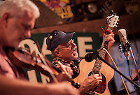 "James Pero on fiddle and Duane Johnson on guitar perform during the annual ""Duanestock"" held in Johnson's 133 year old barn on Saturday.  (Karen Bobotas/for the Laconia Daily Sun)"