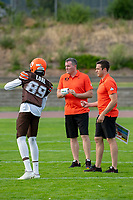 KELOWNA, BC - AUGUST 17:  Chan Lual #89 of Okanagan Sun stands on the field with the coaches during warm up against the Westshore Rebels  at the Apple Bowl on August 17, 2019 in Kelowna, Canada. (Photo by Marissa Baecker/Shoot the Breeze)