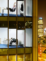 Tired business men in offices view from building exterior