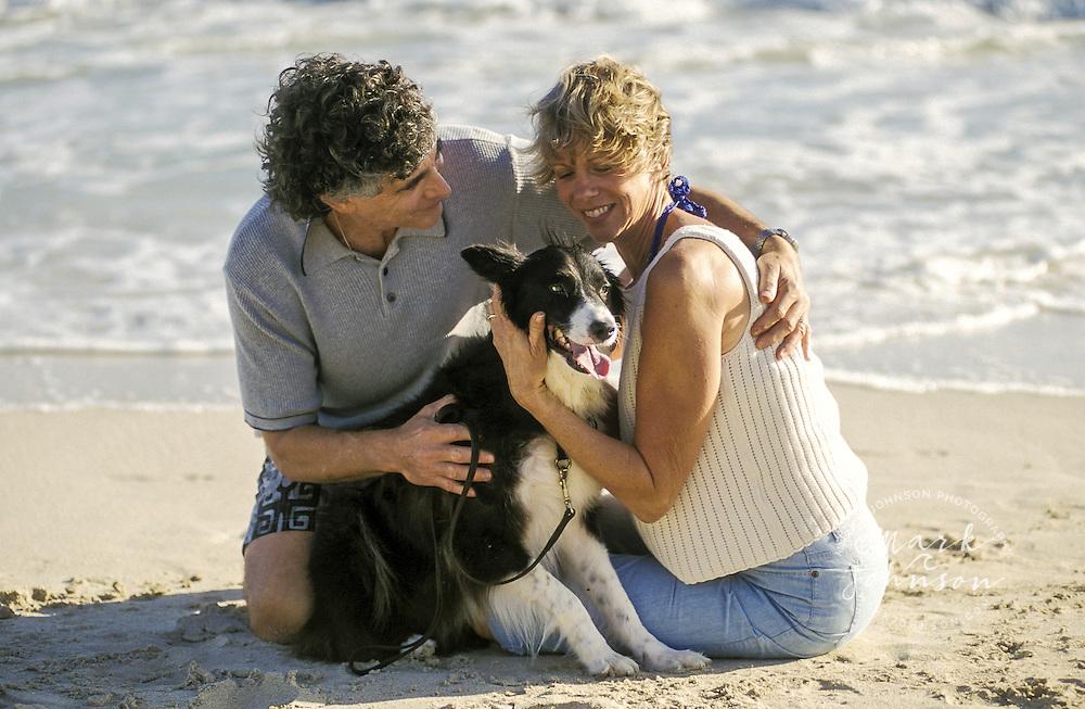 USA, Hawaii, Oahu, Kailua Beach, couple (50's) w/dog.  MR available