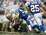 JACKSON, MS - AUGUST 26:  Linebacker Rob Morris of the Indianapolis Colts tackles wide receiver Donte' Stallworth of the New Orleans Saints during a game on August 26, 2006 at Veterans Memorial Stadium in Jackson, Mississippi.  The Colts won 27 to 14.  (Photo by Wesley Hitt/Getty Images) *** Local Caption *** Rob Morris