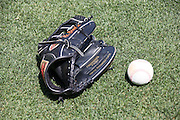 ANAHEIM, CA - MAY 4:  A baseball glove and ball lie on the grass at the Los Angeles Angels of Anaheim game against the Baltimore Orioles on Saturday, May 4, 2013 at Angel Stadium in Anaheim, California. The Orioles won the game 5-4 in ten innings. (Photo by Paul Spinelli/MLB Photos via Getty Images)