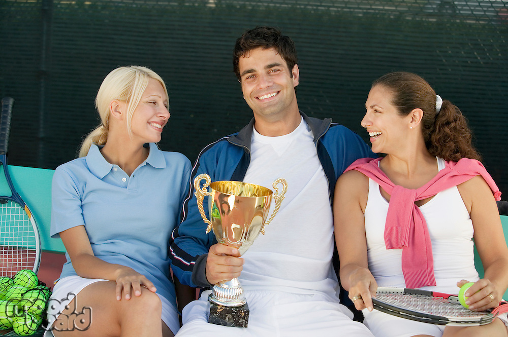 Women with Man Holding Tennis Trophy