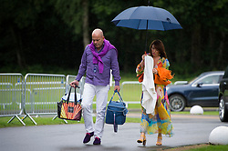 Spectators arrive at the Royal Salute Coronation Cup polo at Windsor Great Park in Surrey.