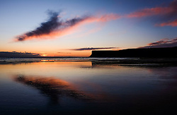 © Licensed to London News Pictures. <br /> 29/04/2016. <br /> Saltburn by the Sea, UK.  <br /> <br /> A cloud glows orange as it is lit by the light from the rising sun over cliffs at Saltburn by the Sea. Further bad weather is expected to come down from the Arctic bringing snow and freezing temperatures to many northern and eastern parts of the country.<br />  <br /> Photo credit: Ian Forsyth/LNP