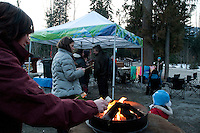 The audience roasts marshmallows while a guitarist sings at the storytelling hour during the 2010 Olympic Winter Games in Whistler, BC