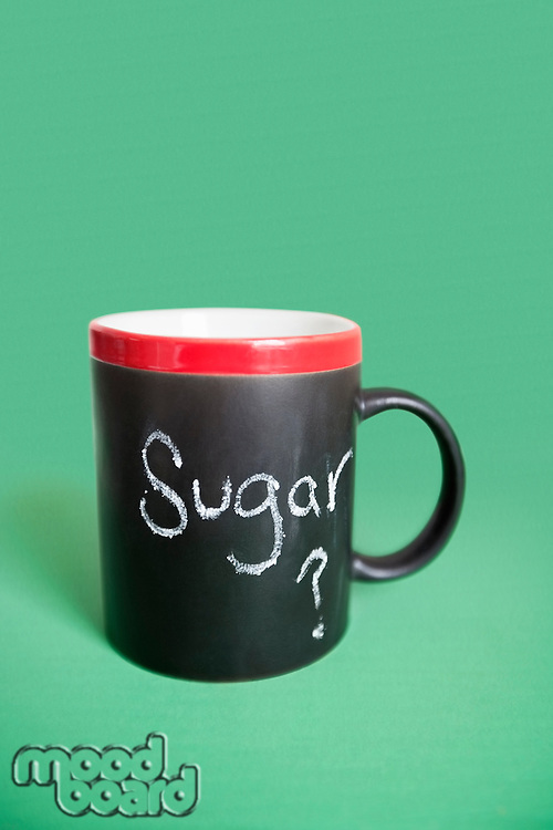 Coffee cup with text over colored background