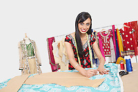 Portrait of beautiful Indian female fashion designer working