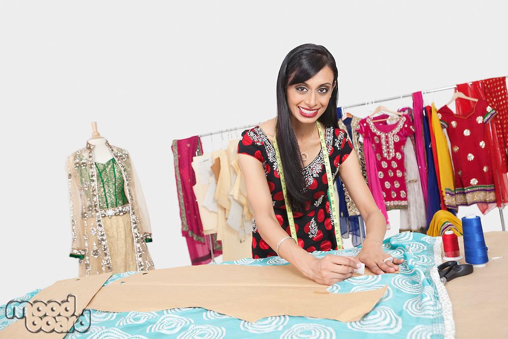 Portrait of beautiful Indian female fashion designer working