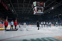 KELOWNA, CANADA - NOVEMBER 11: Jeff Piatelli stands before the national anthem between two RCMP officers standing at attention on the ice for Remembrance Day ceremonies at the Kelowna Rockets against the Red Deer Rebels on November 11, 2017 at Prospera Place in Kelowna, British Columbia, Canada.  (Photo by Marissa Baecker/Shoot the Breeze)  *** Local Caption ***
