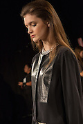 A collarless top with leather panels on the front. By Monika Chiang at Spring 2013 Fashion Week in New York.