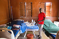 Yahyah abdulai Bangura shows his office next to the construction site. Next month they are expected to open the new extension of the maternity complex with 12 beds, which Yahyah abdulai Bangura will be in charge of. <br /> <br /> In this July he has already helped 6 women delivering her baby. Pregnant women from a radius of more than 10 kilometers to seek help in this facility in the Kunsho Community near the town of Makeni (July 18, 2016).<br /> <br /> This facility is supported The Project Infection Prevention and Control (IFC) and Screening in Primary Health Care Facilities in Sierra Leone.<br /> <br /> The building of the new extension building of the maternity complex is a project by UNICEF and funded by the European Union.<br /> <br /> The MDG Initiative in Sierra Leone - Bridging the gaps to attain MDG 4 and 5:<br /> The desired impact of the program is to contribute to the reduction of the mortality and morbidity of children under 5, infants, newborn and pregnant women in the next three years.
