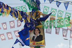 © Licensed to London News Pictures. 30/04/2014. Sulaimaniya, Iraq. An election poster and flags of Kurdish political parties are seen hanging from street furniture during the 2014 Iraqi parliamentary elections in Sulaimaniya, Iraqi-Kurdistan today (30/04/2014). <br /> <br /> The period leading up to the elections, the fourth held since the 2003 coalition forces invasion, has already seen polling stations in central Iraq hit by suicide bombers causing at least 27 deaths. Photo credit: Matt Cetti-Roberts/LNP