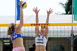 Katarina Juhart of Slovenia strikes and Sara Goller of Germany tries to block the shot at CEV European Continental Beach Volleyball Cup for Olympic Qualification, on September 5, 2010, in Zrece, Slovenia. (Photo by Matic Klansek Velej / Sportida)