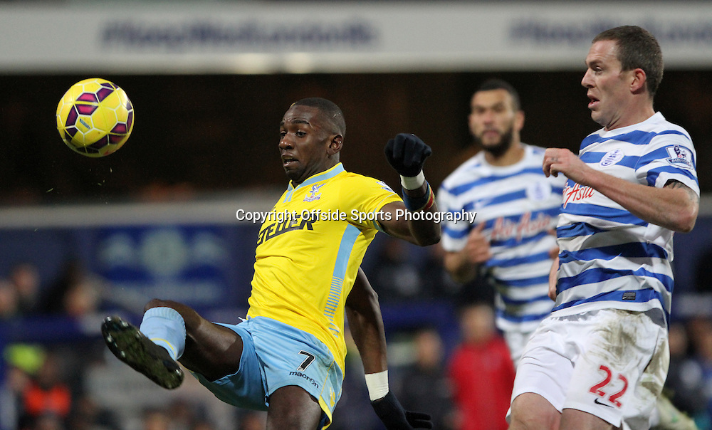 28 December 2014. Premiership. Queens Park Rangers v Crystal Palace.<br /> Yannick Bolasie of Crystal Palace lifts his foot to claim the ball.<br /> Photo: Charlotte Wilson